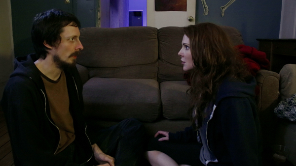 Daniel (Nat Cassidy) and Margot (Jessi Gotta) formulate a plan.